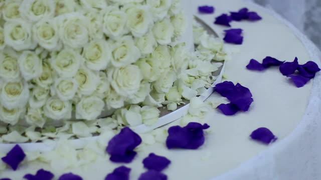 white roses on wedding cake-micro - single rose stock videos & royalty-free footage
