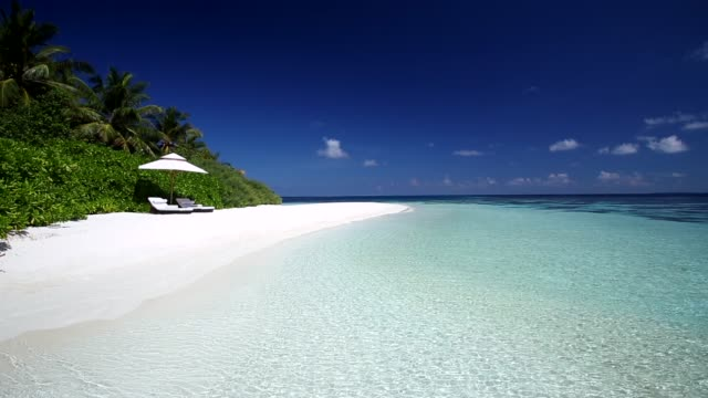 white sand tropical beach and sun loungers, maldives, indian ocean, asia - sun lounger stock videos & royalty-free footage