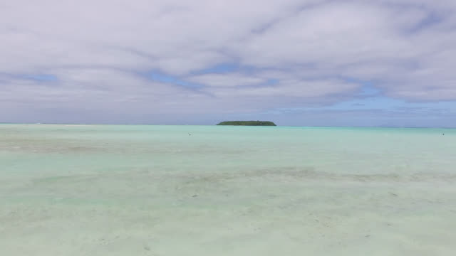 white sandbar in the middle of a lagoon with an island - tahitian culture stock videos and b-roll footage