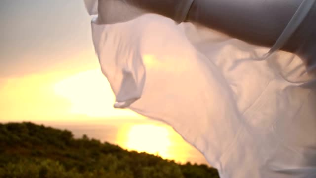 slo mo white shawl fluttering in the wind - shawl stock videos and b-roll footage