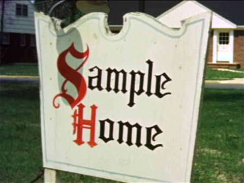 "1959 white sign standing on lawn ""sample home"" / philadelphia, pa / documentary - 不動産の看板点の映像素材/bロール"