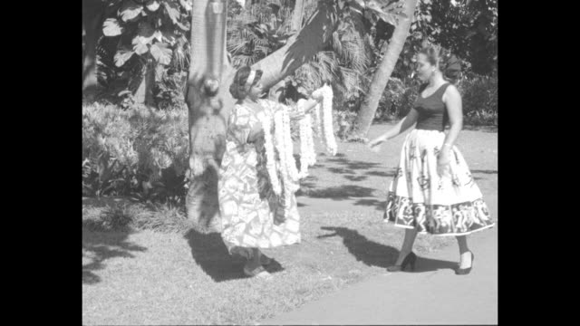 white silhouette of male and female dancing scarecrows / vs female model with full skirt decorated with scarecrows takes lei from heavy hawaiian... - skirt stock videos & royalty-free footage