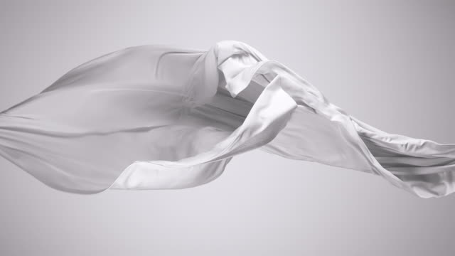 vídeos de stock, filmes e b-roll de white silky fabric flowing by wind in grey background, slow motion - vento