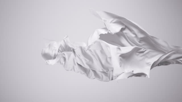white silky fabric flowing by wind in grey background, slow motion - textile stock videos & royalty-free footage