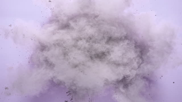 white silver colored powder exploding towards camera in close up and super slow-motion, light purple background - silver coloured stock videos & royalty-free footage