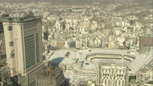 white skyscrapers surround the sacred site of kaaba in mecca. - mecca stock videos and b-roll footage