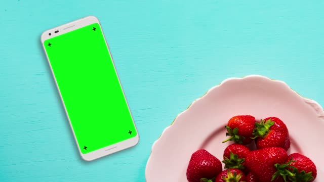 white smartphone on blue table chroma key green screen - mobile app stock videos & royalty-free footage