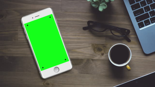 White Smartphone on Desk with Chroma Key Green Screen
