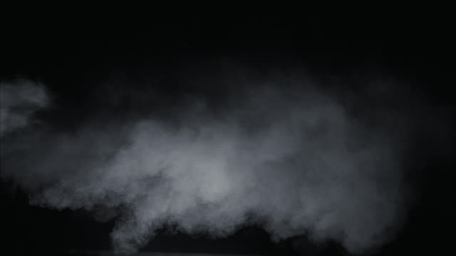 vidéos et rushes de cu white smoke against black background - fumée