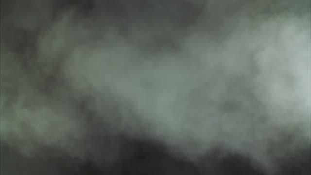 White smoke fills a room.