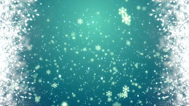 White Snowflakes on blue background 4K loop