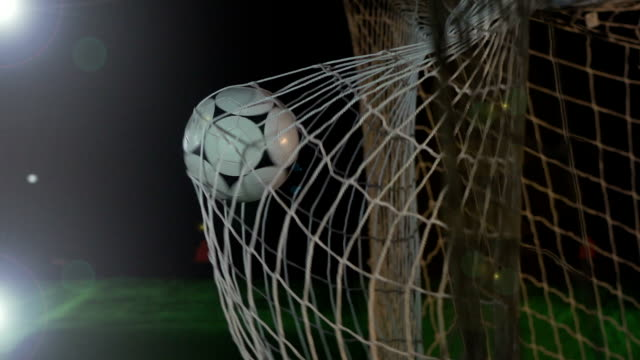goal: white soccer ball / football being scored in net - super slow motion - ball stock videos and b-roll footage