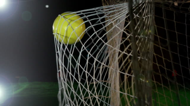 goal: white soccer ball / football being scored in net - super slow motion - scoring stock videos and b-roll footage