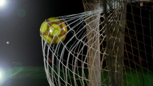 goal: white soccer ball / football being scored in net - super slow motion - netting stock videos and b-roll footage