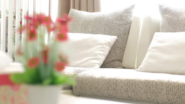 White sofa in living room with dolly shot movement