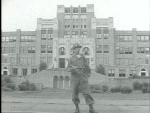 white students enter the front doors of little rock high school as a police officer swings a billy-clubs during the integration movements in the late... - caucasian ethnicity stock videos & royalty-free footage