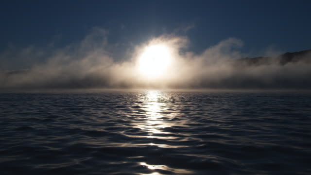 White sunlight reflects off Lake Tarawera in New Zealand.