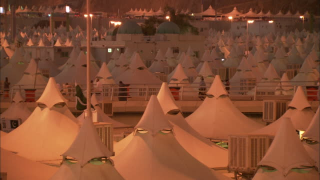 white tents crowd a campsite at mecca. - mecca stock videos and b-roll footage