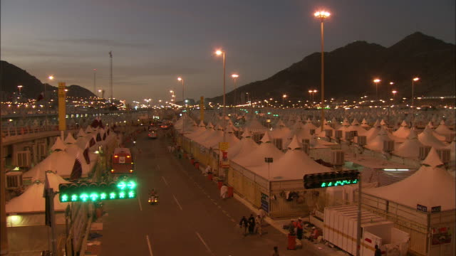 white tents fill mina, also known as tent city, in mecca, saudi arabia. - tent stock videos and b-roll footage