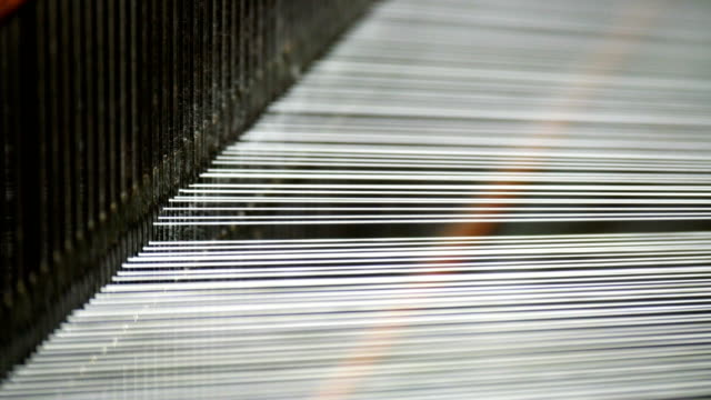 white threads on a loom in retro classical style warp knitting  machine - woven stock videos & royalty-free footage