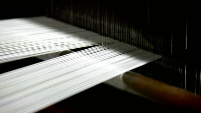 white threads on a loom in retro classical style warp knitting  machine - spool stock videos & royalty-free footage
