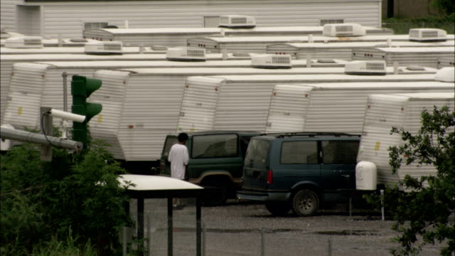 white trailers parked closely together. available in hd. - hurricane katrina stock videos and b-roll footage