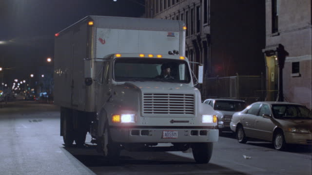 a white truck drives up close at night. - caucasian ethnicity bildbanksvideor och videomaterial från bakom kulisserna