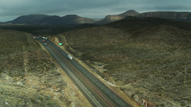 white trucks heading up hill on interstate 10 in west texas - aerial - interstate 10 stock videos & royalty-free footage