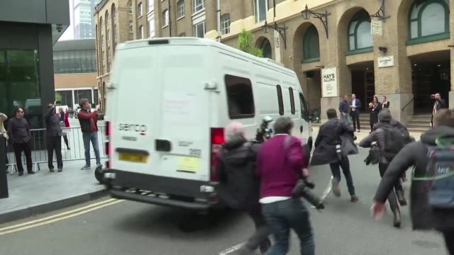 A white van carrying Julian Assange leaves court after the WikiLeaks founder was sentenced to 50 weeks in jail for breaching a British court order...