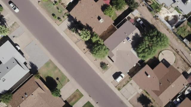 white van on residential street - phoenix arizona stock-videos und b-roll-filmmaterial
