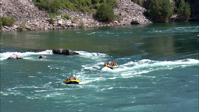 white water rafting  - aerial view - montana, lake county, united states - rafting stock videos & royalty-free footage