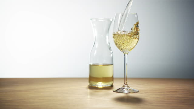 white wine being poured in glass - high speed video - white wine stock videos & royalty-free footage
