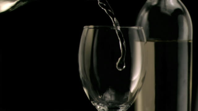 white wine being poured in super slow motion - cork material stock videos & royalty-free footage
