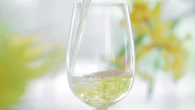 cu white wine being poured into glass / connecticut, usa - white wine stock videos & royalty-free footage