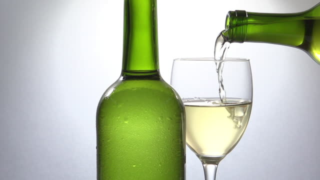 white wine being poured into glass, slow motion - white wine stock videos & royalty-free footage