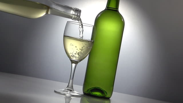 White Wine being poured into Glass, Slow motion