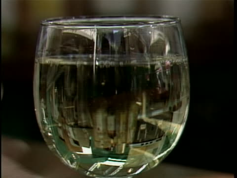 white wine is poured into a glass - wine glass stock videos & royalty-free footage