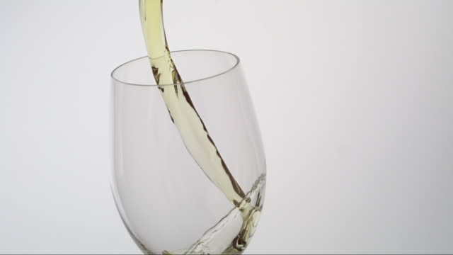 white wine pouring into a glass - swirl stock videos & royalty-free footage