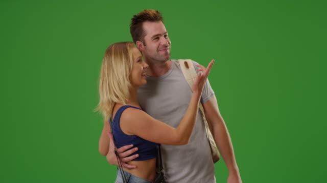 white woman girlfriend points on green screen - zeigen stock-videos und b-roll-filmmaterial