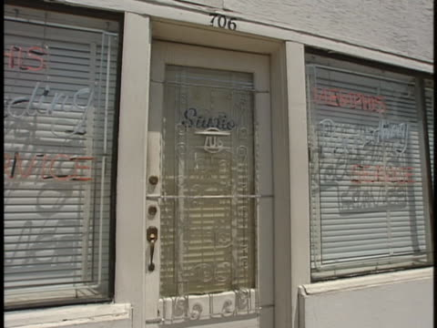 white wrought-iron door stands at the entrance to sun records studio in memphis, tennessee. - blinds stock videos & royalty-free footage