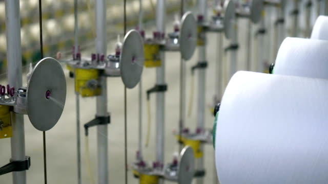 white yarn spools of industrial  warping machine  in textile factory - textile stock videos & royalty-free footage