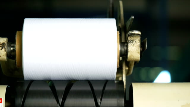 white yarn spools of industrial  warping machine  in textile factory - ball of wool stock videos & royalty-free footage