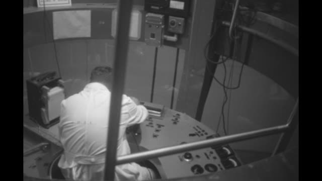 whitecoated technicians looking at electrocardiogram with several ink needles drawing on roll of graph paper / man in semicircular room as disk... - graph paper stock videos and b-roll footage