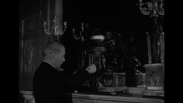 Image result for images of butler winding clocks