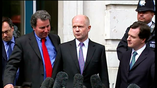 stockvideo's en b-roll-footage met conservative negotaiation team from cabinet office and surrounded by press william hague mp statement to press sot we've made further progress in our... - william hague