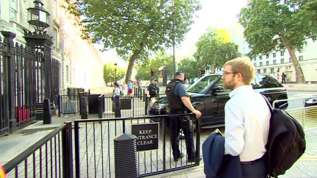 whitehall gate cabinet arrivals; england: london: westminster: whitehall: ext police presence / theresa villiers mp arriving / cars arriving / ben... - cabinet member stock videos & royalty-free footage