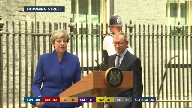 whitehall: motorcade turning into downing street downing street: various of motorcade stopping and may and her husband philip out and may walks to... - 12 13 years stock videos & royalty-free footage