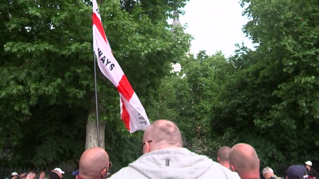 whitehall protest / edl march; embankment: anti-fascist protesters / edl demonstrators with england flags / edl and other anti-muslim protesters... - other stock videos & royalty-free footage