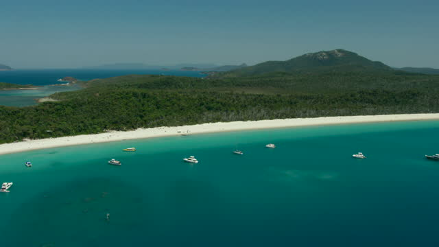 whitehaven beach aerial luxury yachts ocean coral reef - anchored stock videos & royalty-free footage