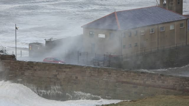 whitehaven harbour and sea cliffs during the december 2014 period of storm surge high tides and storm force winds the coastline took a battering... - weathered stock videos & royalty-free footage